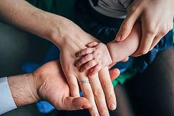 vecteezy_family-of-three-s-hands_2242092.jpg