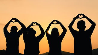 vecteezy_group-of-people-with-raised-arms-and-make-hand-to-the-heart-shape-looking-at-sunr