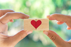 vecteezy_hand-holding-wooden-cube-with-heart-sign-icon-with-natural-sunlight_2075738.jpg