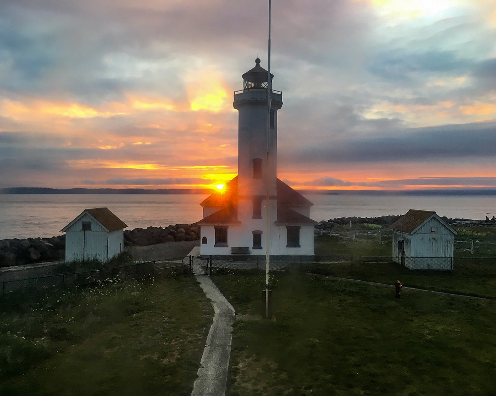 Photo of sunrise at the Point Wilson lighthouse from the keeper's house