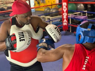 peek a boo mitts in ring.jpeg