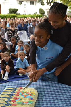 The cutting of the 30th birthday cake by