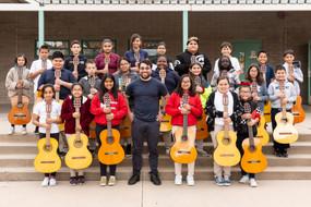 "Tucson Regional Director Alfredo ""Freddy"" Vazquez poses with students at Morgan Maxwell School in Tucson, Arizona, early 2020."