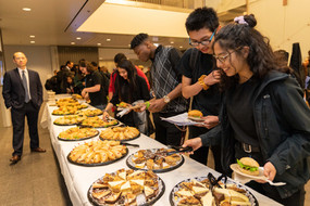 Chicago students dig into food at the 2019 Showcase Concert held at the University of Chicago's Logan Center.