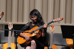 A Baboquivari high school student finishes her solo at the 2019 Tucson showcase concert.