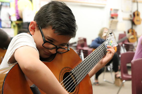 Brandon, a J. Robert Hendricks Elementary School student of Tucson, plays with his chord buddy, using our Adaptive Curriculum, 2019.