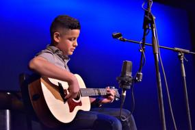 2017 Wellness Through the Arts Grand Prize Awardee, Ismael Mercado of Hollinger K–8 in Tucson, Arizona, performs his original song at the University of Arizona.