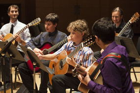 Brad Richter and Colorado Regional Director Nick Lenio play with students at the 2015 Aspen showcase concert.