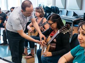Chicago Regional Director Denis Azabagic helps teachers at the 2019 Teachers' Workshop in Los Angeles.