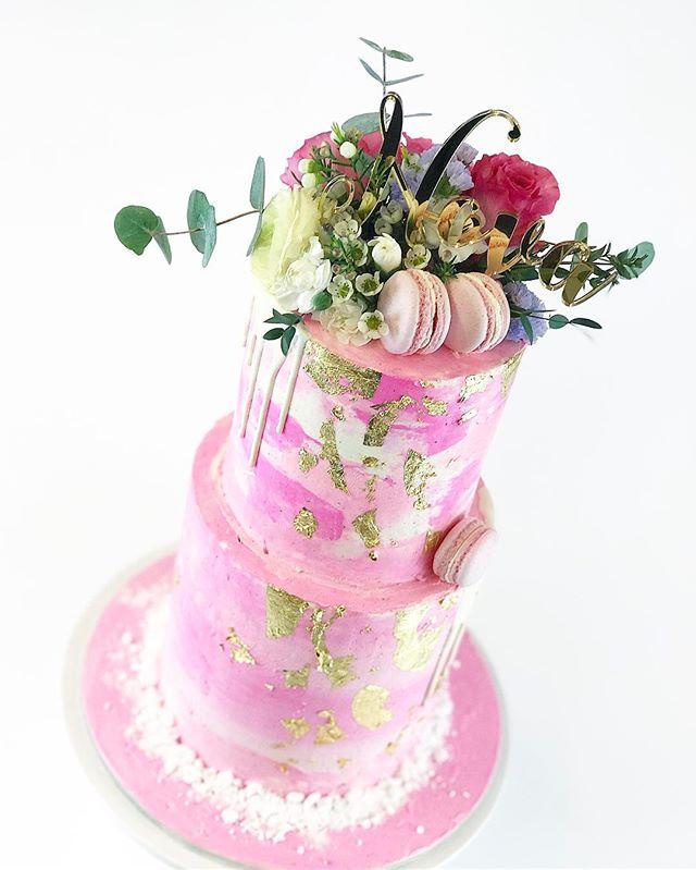 Novas christening cake with pinks and go