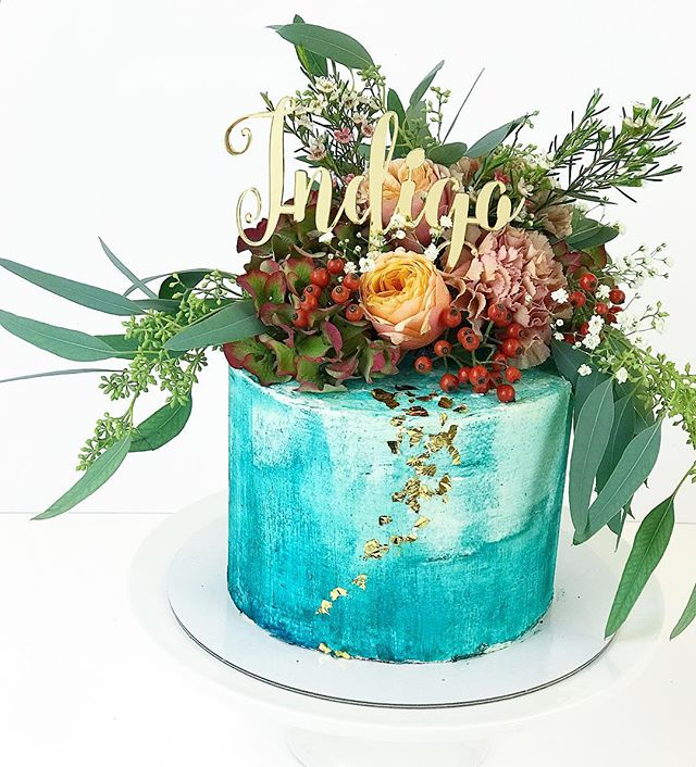 Water colour and autumn flower decorate Indigo's lovely cake
