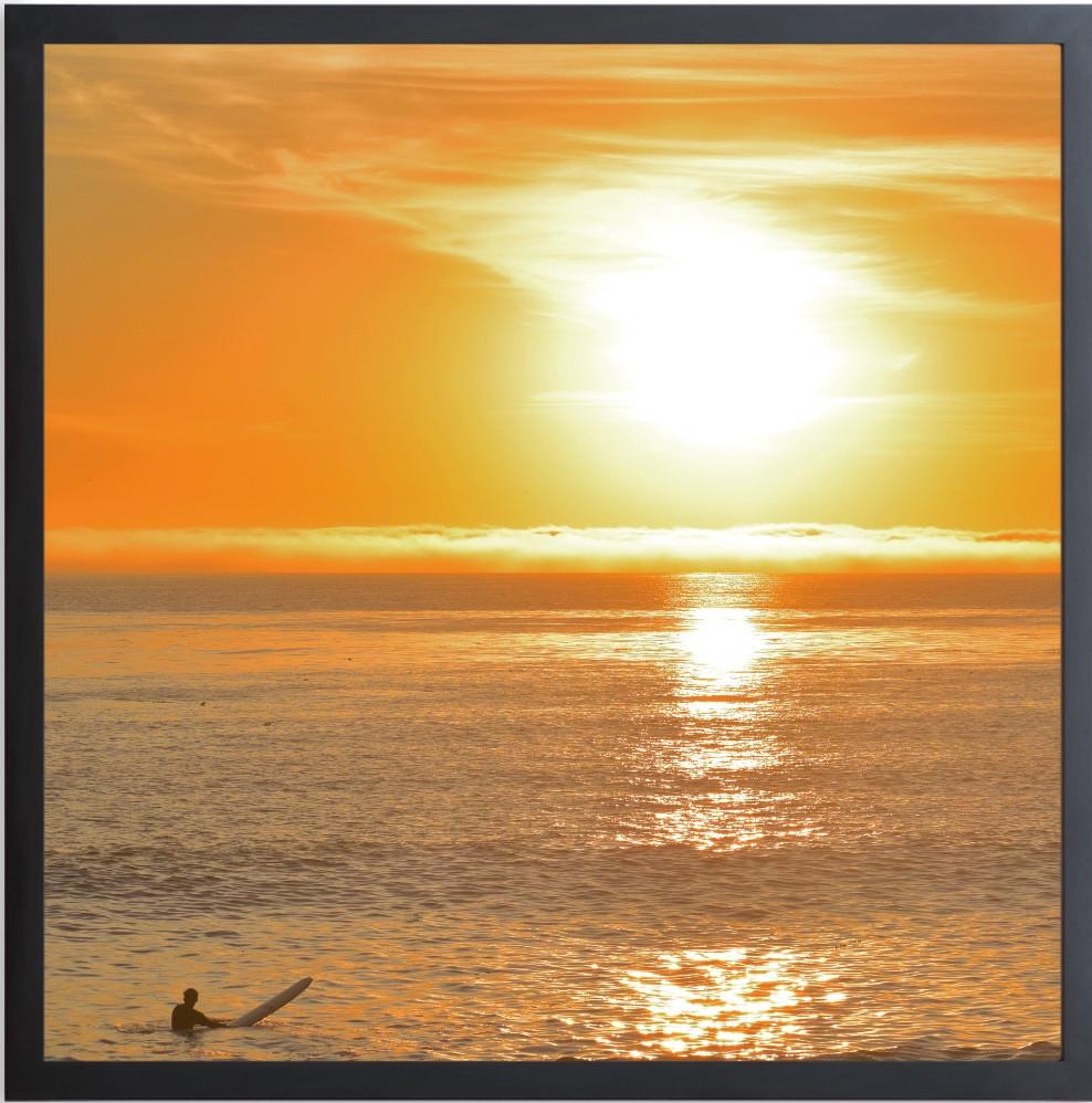 SUNSET SOLO SURFER