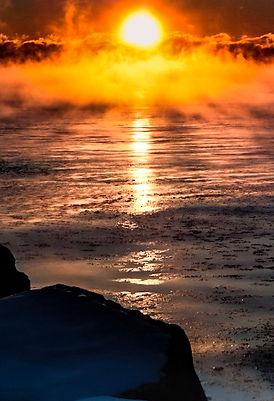 exploding setting sun on water.JPG