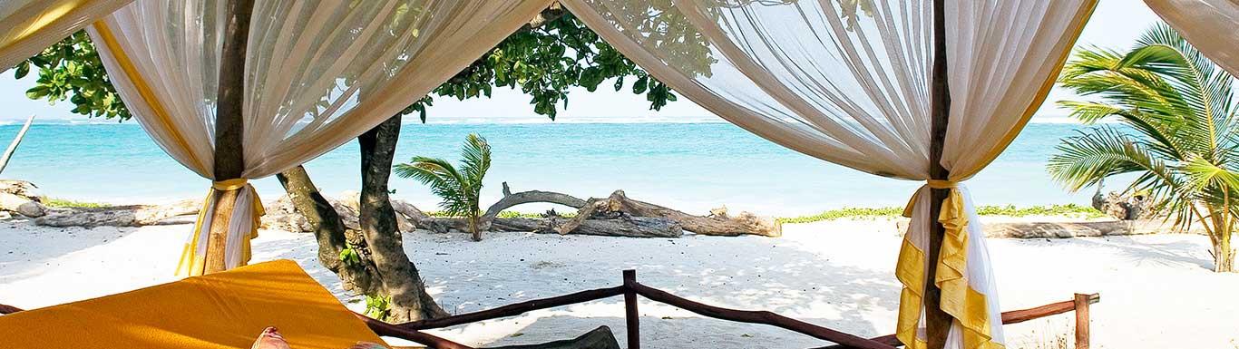 AfroChic---Swahili-bed-on-beach.jpg