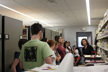 Heather Calloway gives sudents a tour of the college archives