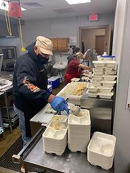 kitchen staff dishing up meals.jpg