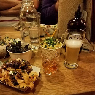 The spread from _durksbbq. That is #fritopie, #macncheese, a barbecue #oldfashioned (on tap), and gose.jpg