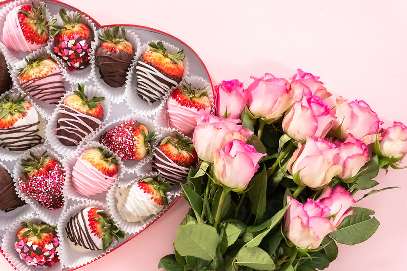 Flat lay. Variety of chocolate dipped strawberries in a heart-shaped box..jpg