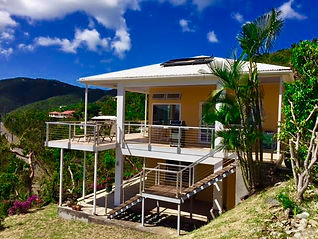 Coral Livin' is located on the hillside overlooking Coral Bay Harbor and the surrounding hills.