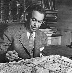 Paul R. Williams working at his desk