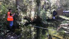 The WWLA team stream gauging at Muriwai using a Sontek FlowTracker