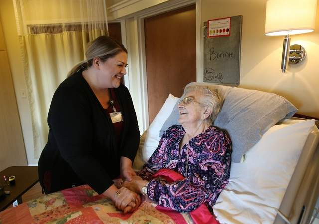 LOREN BENOIT/Press Nurse Tracy Foster shares a lighthearted moment with Bonnie Rothrock on Tuesday at Hospice of North Idaho Schneidmiller Hospice House. Hospice was highlighted at the Coeur d'Alene Chamber of Commerce's Upbeat Breakfast and helped more than 1,500 patients last year.
