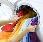 Taking towels out of the washer