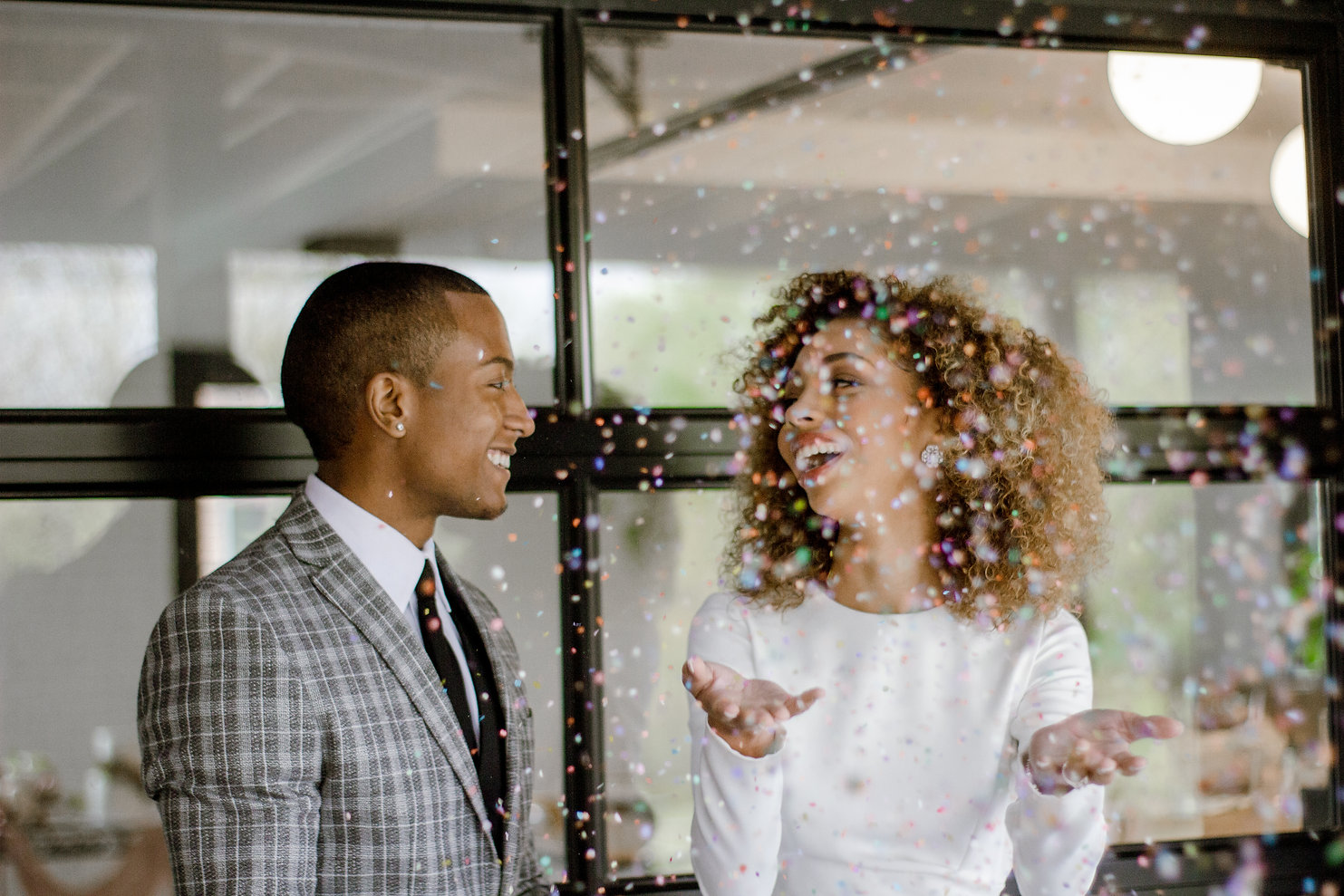 bride and groom throwing confetti