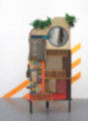 78x86x64 (installation), 78x34x25 (object), wood, cardboard, steel, glass, plastic, raffia, artificial plants, tape, acrylic paint, found items