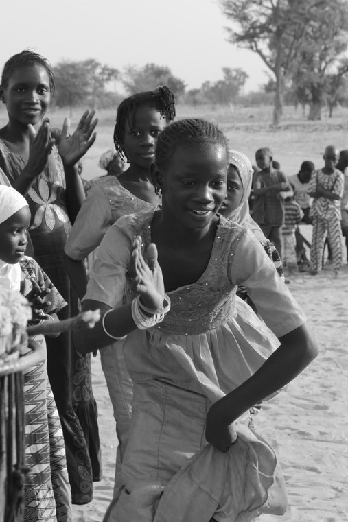 Senegalese girl dancing to the drums