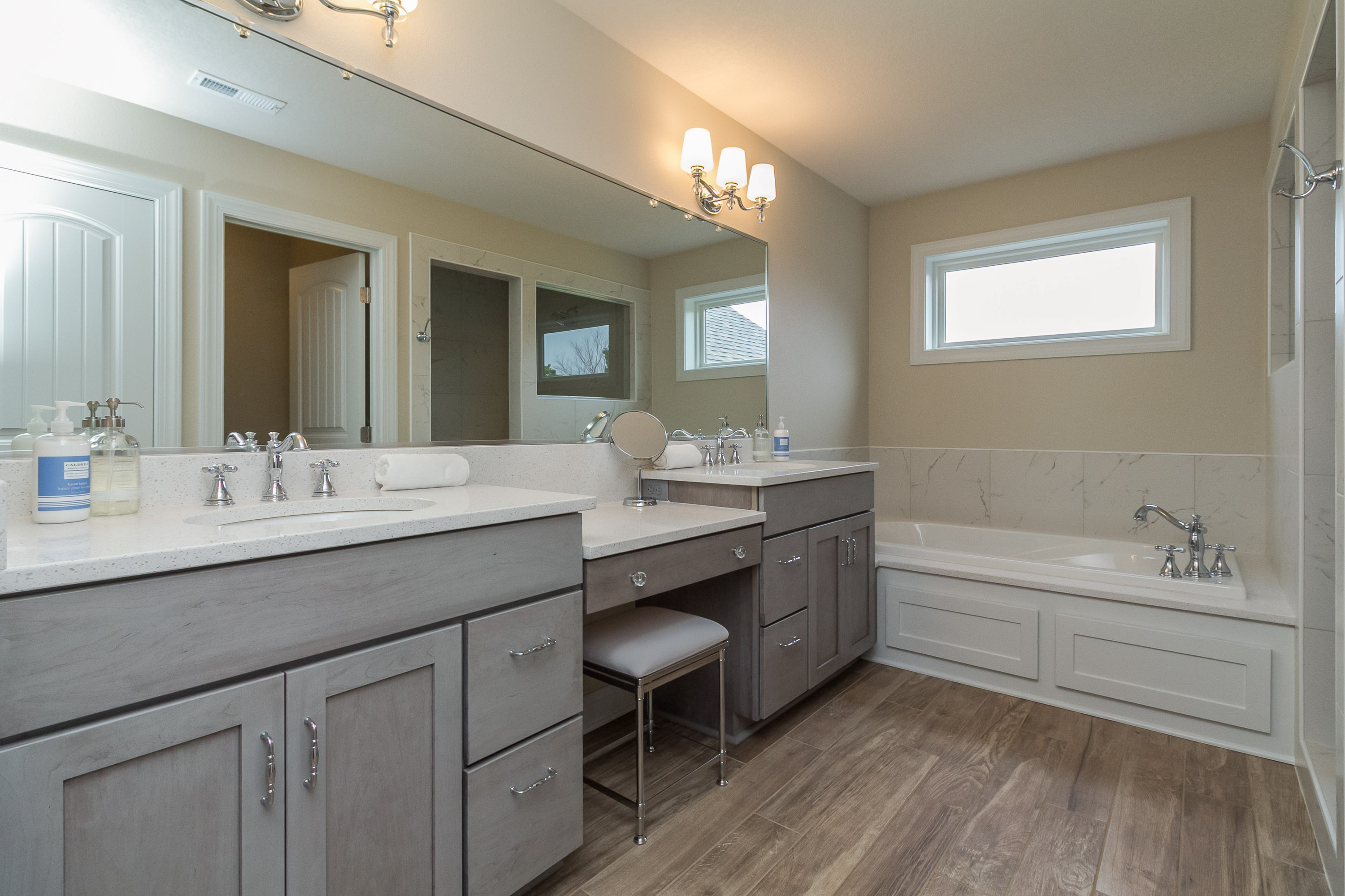 Master Bath with Wood Floor Tile and Makeup Vanity