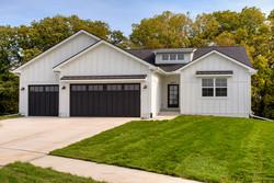 Modern Farmhouse White Ranch by Des Moines Custom Home Builder
