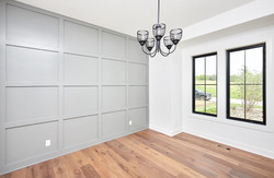 Gray Panel Wall in Office with Chandelier