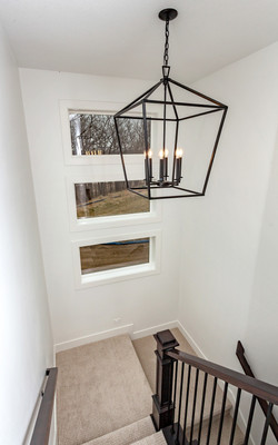 Open Staircase with Chandelier