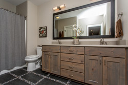 Stained Cabinetry with Pattern Tile Floor