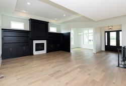 Black Built Ins with Quartz Fireplace Surround