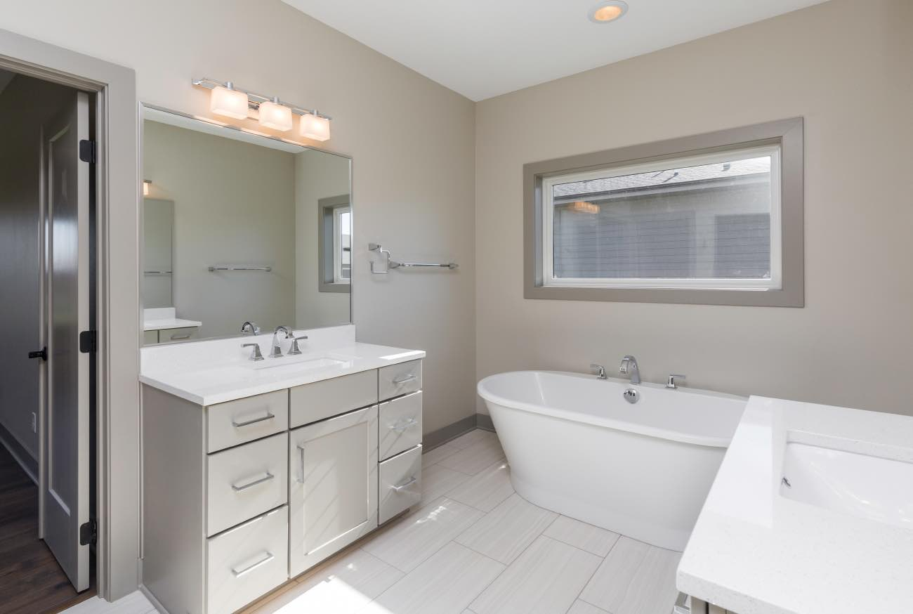 Spa Like Light Gray Master Bathroom in New Home
