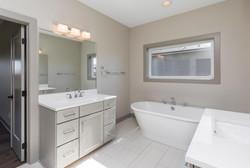 Spa Like Light Gray Master Bathroom in New Home