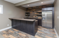 Bar in Finished Basement by Best Home Builder in Des Moines
