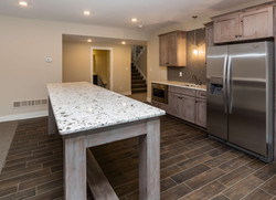 Basement Bar with Table by Des Moines Home Builder