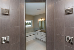 Dual Shower Heads in Master Bath with Gray Tile