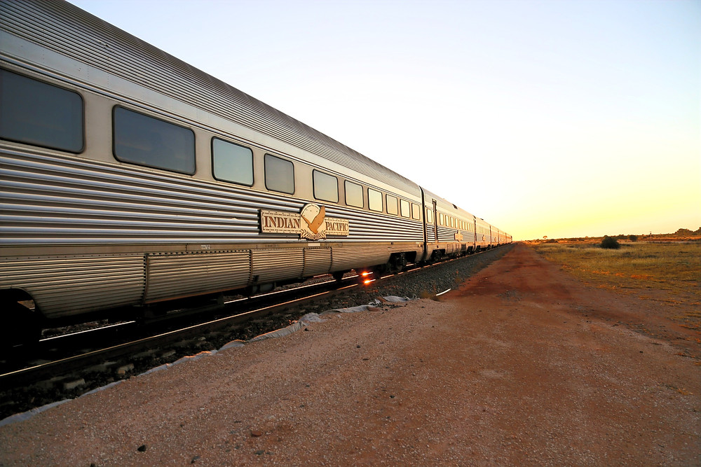 Indian Pacific at sunrise.  Passenger train carriages