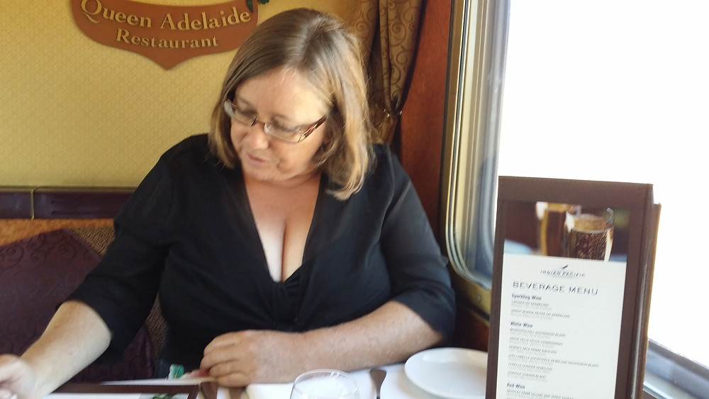 Reading the menu in the dining car on board the Indian Pacific train