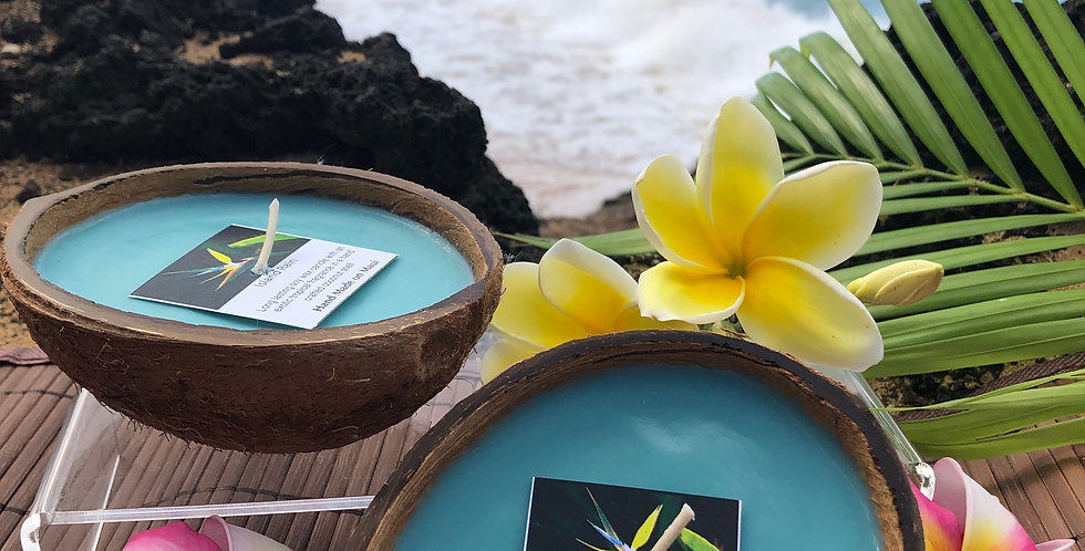 Island Rain Soy Wax Candle in a Floating Coconut Shell.  Light Turquoise in Color, Smells like a Dew Kissed Rain Forest