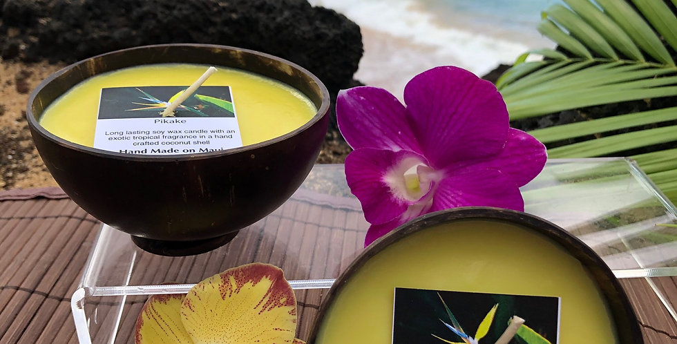 Pikake Soy Wax Candle in a Polished Coconut Shell.  Yellow in Color, Smells like Hawaiian Jasmine.