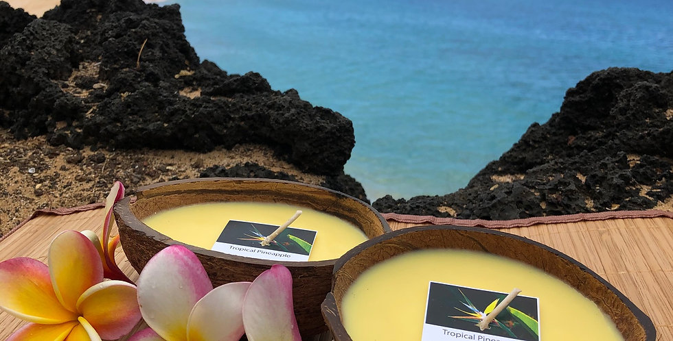 Tropical Pineapple Soy Wax Candle in a Floating Coconut Shell.  Color Yellow. Smells like Sweet Fresh Island Pineapple.