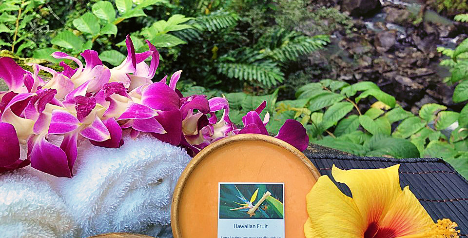 Hawaiian Fruit Soy Wax Candle in a Monkeypod Wood Bowl.  Orange in Color, Smells like Mango, Papaya, Passion Fruit & Guava.