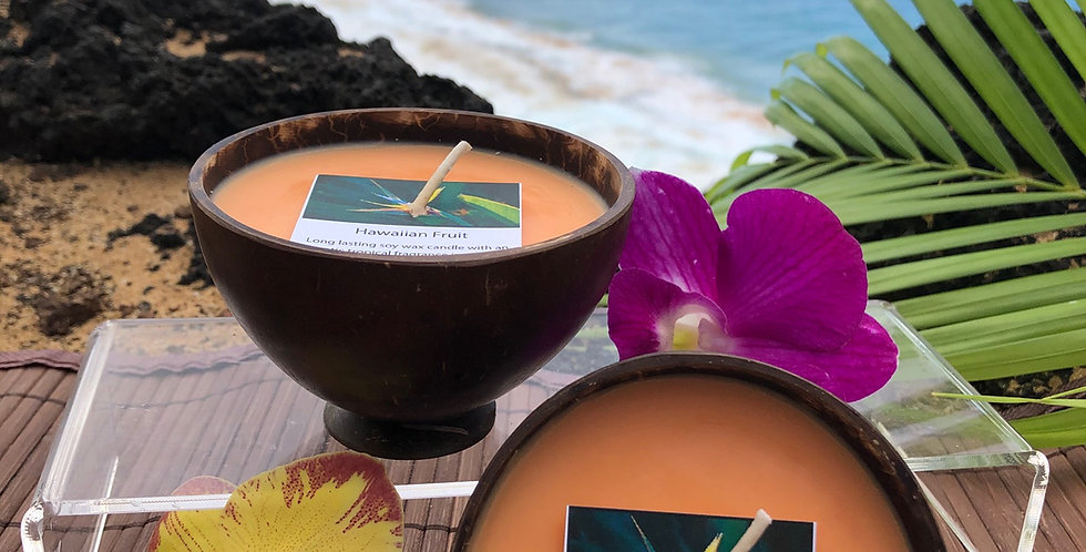 Hawaiian Fruit Soy Wax Candle in a Polished Coconut Shell.  Orange in Color, Smells like Passion Fruit, Mango, Papaya, Guava.