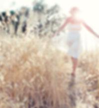 Woman Walking in the Field