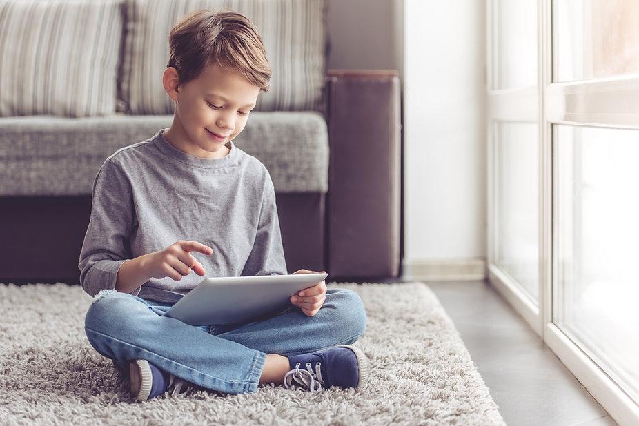 Dyslexic boy with tablet.jpg